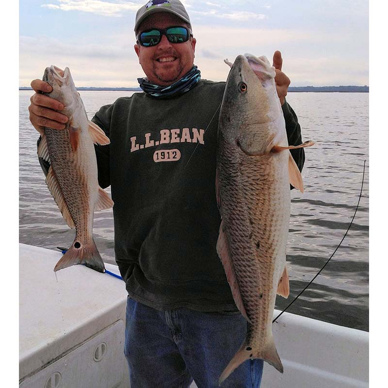 Captain Ron Davis with two redfish caught on back-to-back casts with the WillowVibe