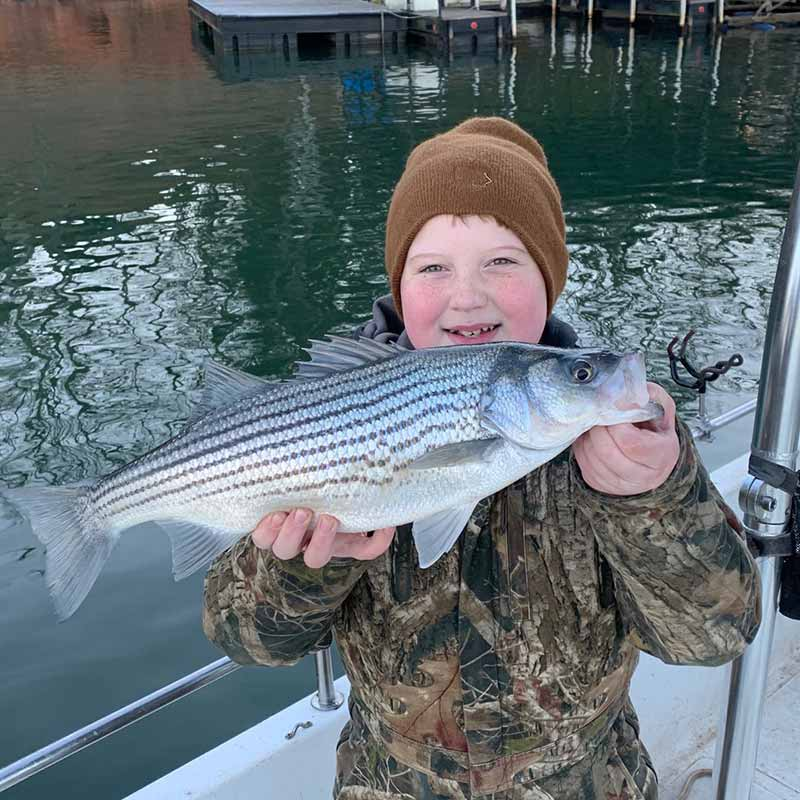 A young angler caught this nice hybrid with Guide Chip Hamilton