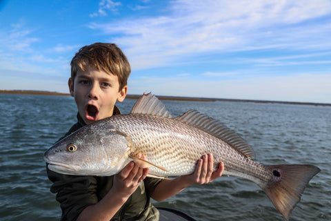 A young angler shows off a beauty caught this week with Captain Tuck Scott
