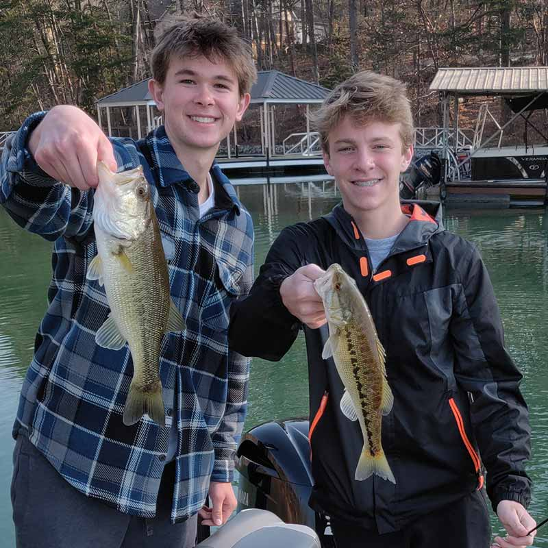 A couple of young anglers with Keowee bass caught earlier this week in shallow water