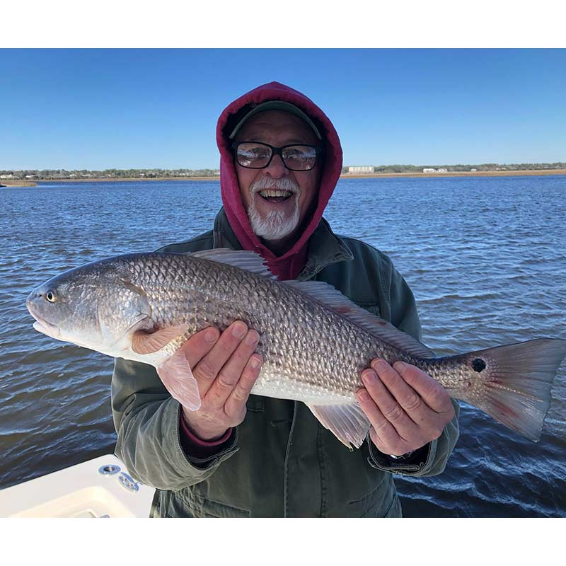 A nice redfish caught this week with Captain Smiley Fishing Charters