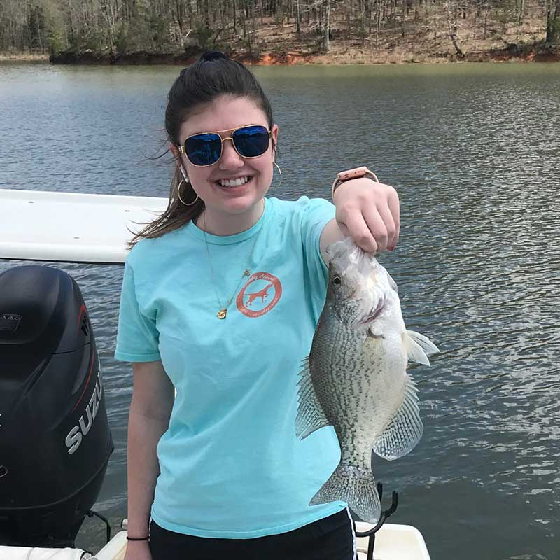 Emaleigh Lance with some nice crappie caught on Wendell Wilson's boat just before the spawn busted open