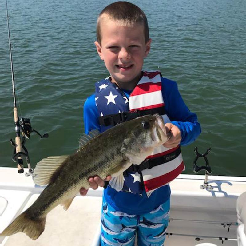 Jerry Kotal guided this patriotic young angler to a nice Lake Russell bass