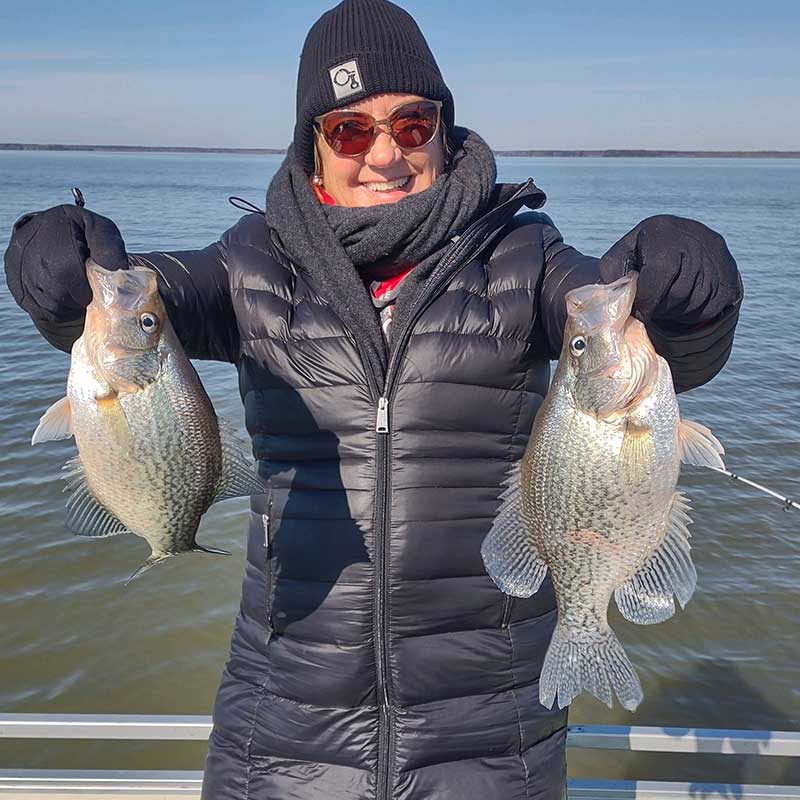 Linda Lou with a nice pair of fish caught with Captain Steve English