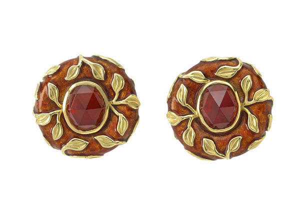 A gorgeous pair of 18ct yellow gold earrings featuring oval rose cut red-brown garnets (8.16cts in total). The earrings are decorated with gold leaf motifs and brown enamel.