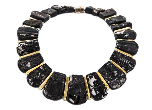 A most exquisite necklace with shaped black tourmaline crystals alternated with molten gold bars and a molten clasp.