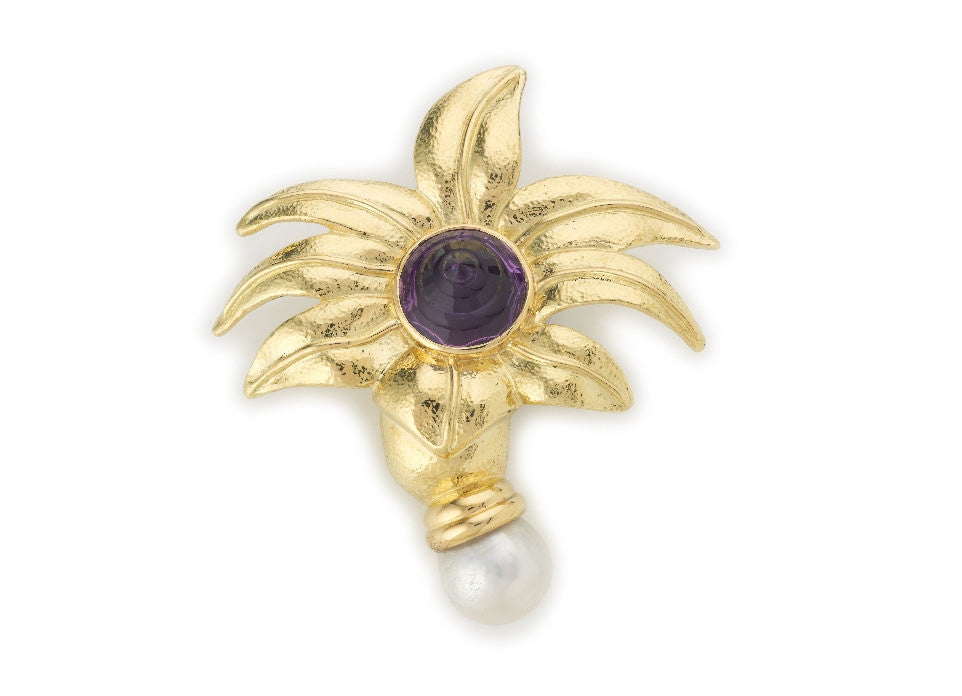 This stunning Acanthus pin is set with a beautifully carved amethyst in the centre and a South Sea baroque pearl in a double layered cap at the bottom. The flower has a light repoussé finish.