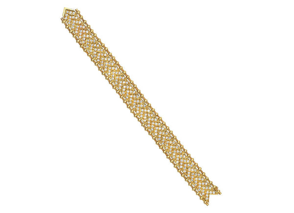 This bracelet is made with gold chevron sections set with diamonds and linked together with a foxtail chain.