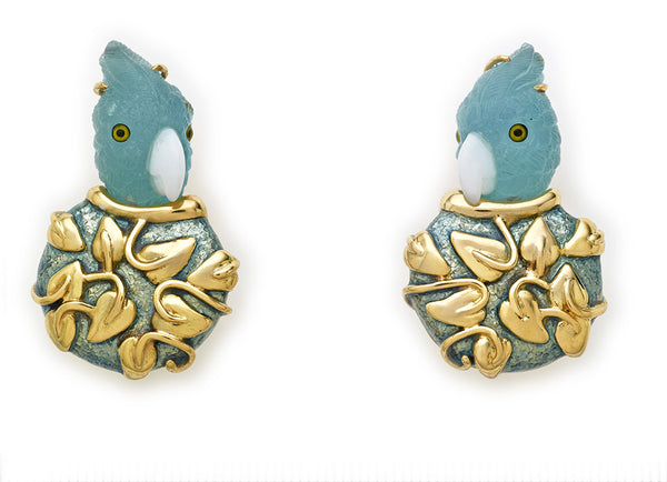 A gorgeous pair of 18ct yellow gold earrings featuring aquamarine parrot head carvings with lovely opal beaks and painted eyes. The earrings are decorated with carved gold myrtle leaf motifs and aquamarine enamel.