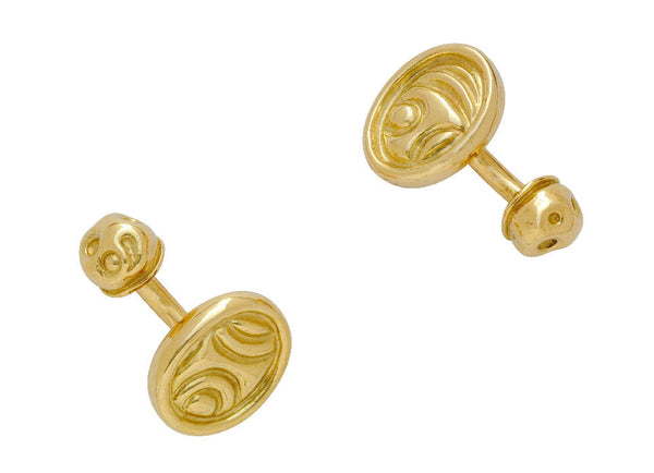 Yellow gold cufflinks featuring a carved gold plaque and molten bead backs.