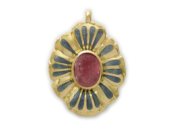 A fabulous 18ct yellow gold pendant featuring a beautiful oval rubelite cameo of a classical lady's head in profile surrounded by gold flower petals decorated with grey enamel.