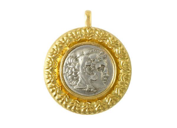 A pendant set with a Greek silver coin of Alexander The Great  in a surround of leaf motifs.