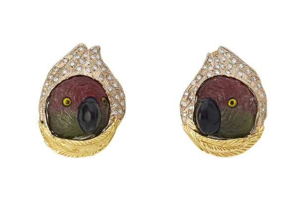A lovely pair of 18ct yellow and white gold earrings featuring bi-colour tourmaline parrot head carvings. The heads are pushing through white gold feathers pavé set with diamonds. Under the heads are yellow gold hand engraved feathers.