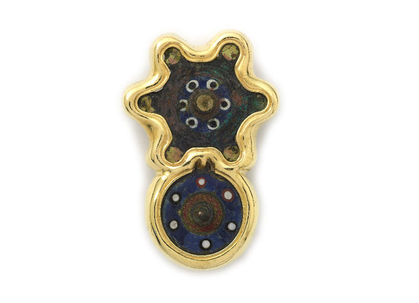 An unusual pin, featuring two Roman bronzes from the 2nd century AD, with original enamel, set in a simple molten gold surround.