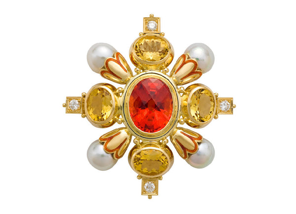 A stunning Kiss pin featuring a gorgeous oval dark mandarin garnet, surrounded by four oval faceted yellow beryls. In between each of the beryls is a lovely fluted gold funnel with a scalloped edge, decorated with a striking orange enamel, holding a baroque grey pearl. On the outer edge of the beryl settings is a carved square plinth set with a diamond and decorated with three gold beads.