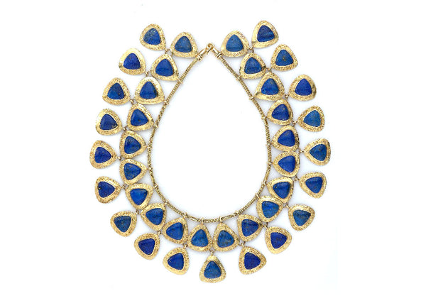 A sensational necklace based on the Egyptian jewellery of Nefertiti. Featuring two rows of beautiful triangular shape cabochon lapis set in granulated gold surrounds. The necklace is finished with foxtail chain and closed with a hook clasp.