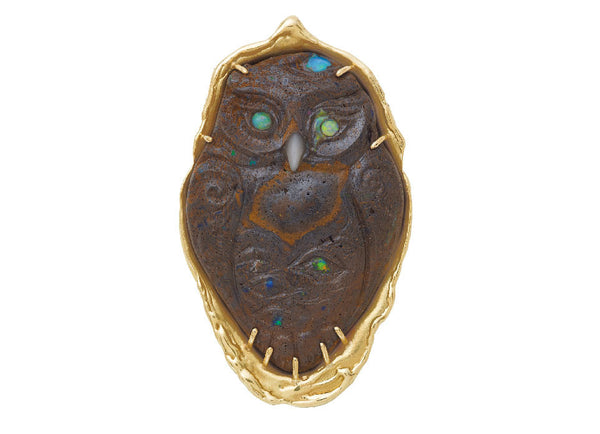 Unique and whimsical owl carved in boulder opal with a mother-of-pearl beak and opal eyes. The is set in a surround of molten gold.