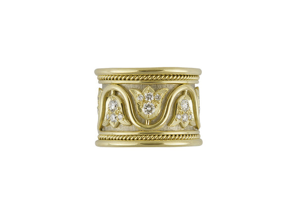 A beautiful 18ct yellow and white gold Templar band ring decorated with thirty-two round brilliant cut diamonds (0.84cts in total) set in eight lovely tulip head motifs.  The ring is finished with a wire-twist-wire edge.