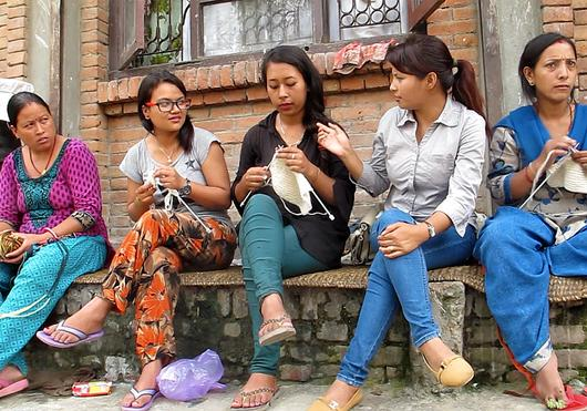 Yarn is distributed to women group leaders who manage communities of knitters in villages around the Kathmandu Valley.