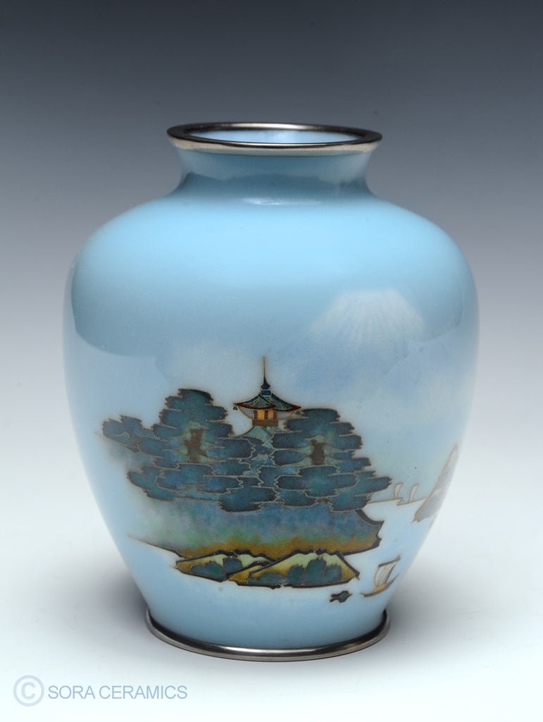 sky blue cloisonne vase with design