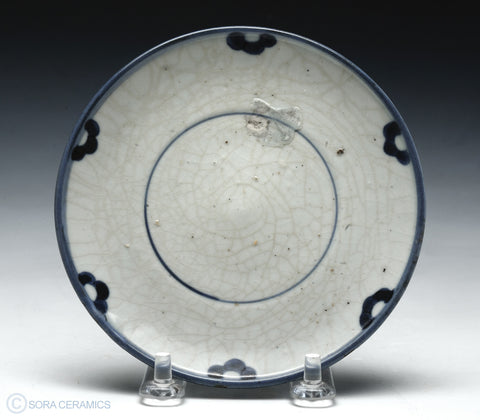 Old Imari dish, simple white with blue rim, crackled glaze