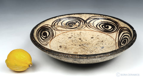 pottery bowl with brown swirl design