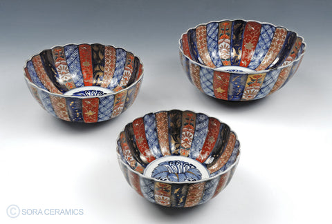 Imari bowls, reds, blues, persimmon, gold