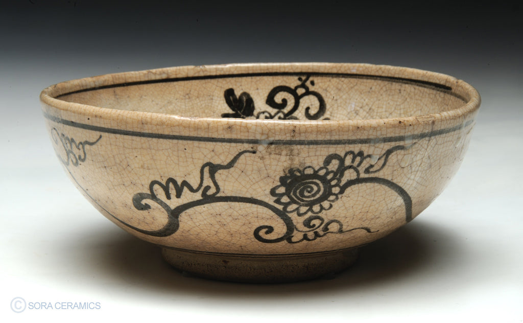 pottery bowl, cream with brown brushwork designs