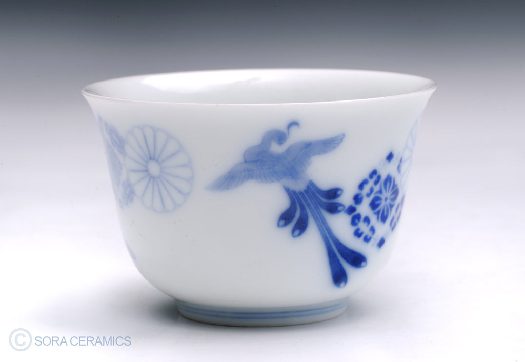 white cup with blue floral designs
