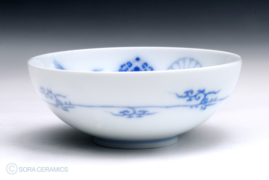 white bowl with blue floral designs