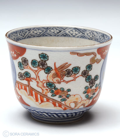 Imari choko cups, blue and white with polychrome designs
