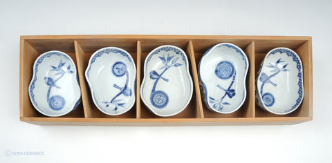 asymmetrically shaped blue and white small deep bowls