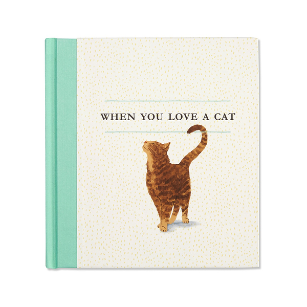 "Book cover featuring an illustrated friendly, content cat, looking up at the title of the book, ""When You Love A Cat"""