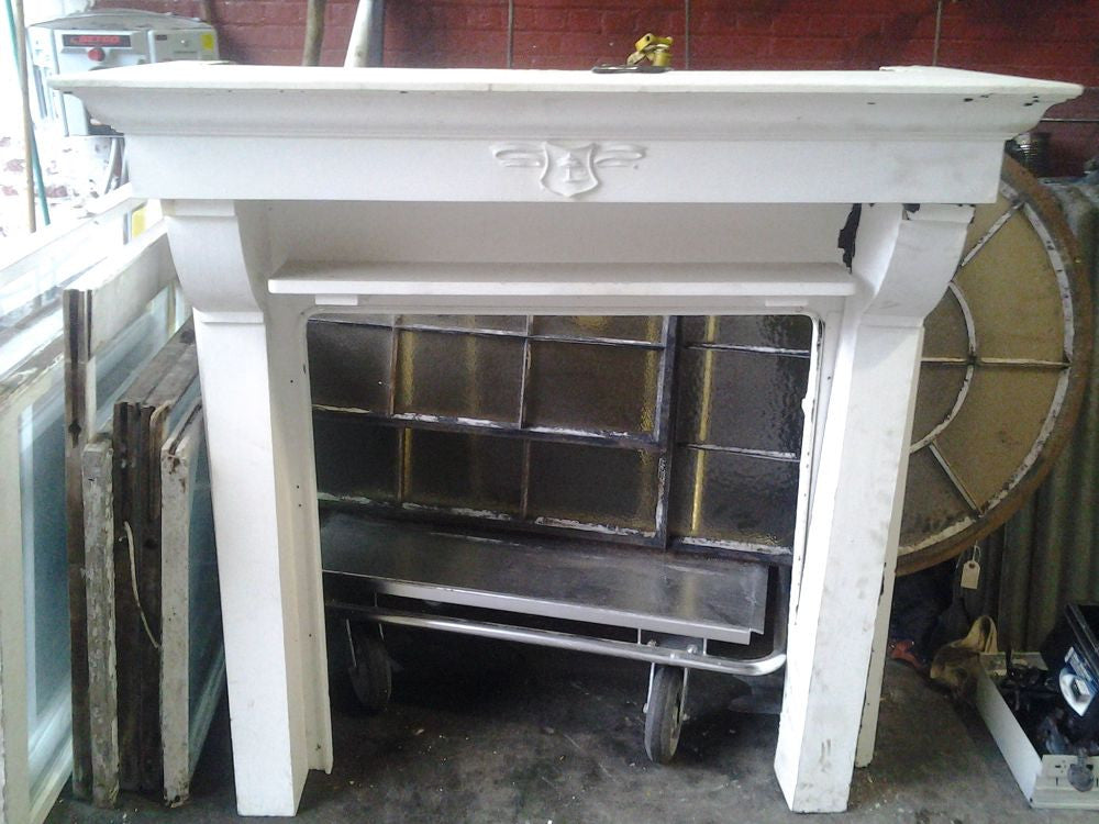 Painted Antique White Wood Fireplace Mantel with Squared Columns and Decorative Tree Plaque in Center salvaged from the circa 1850 Zinc Mine Master