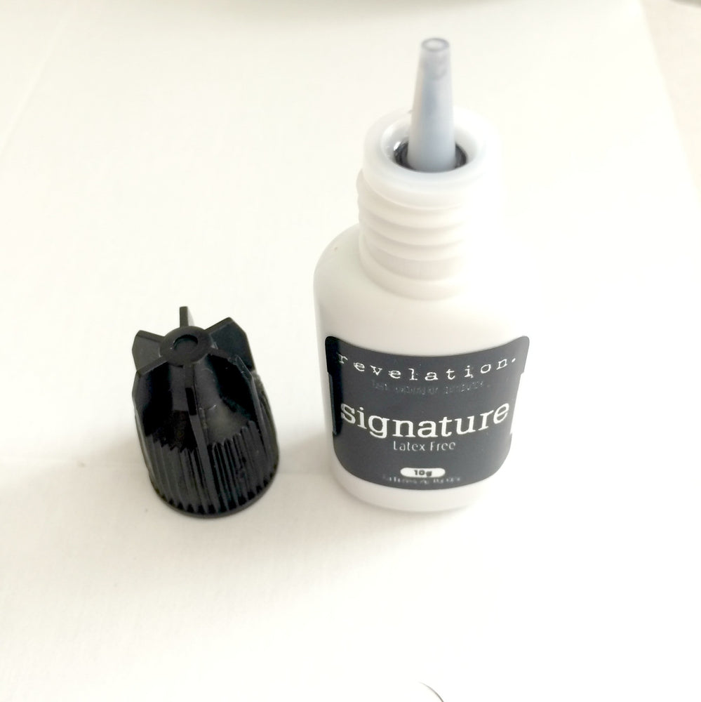 image of Signature Latex Free Eyelash Extension Glue standing up with lid off