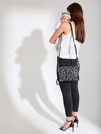 The Chic Baby Clutch - Black & White Leather Baby Nappy Bag - Model with Bag - She Lion