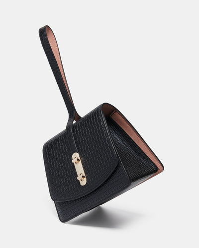 The Connector - Black Leather Clutch Bag - Side Tilted View - She Lion