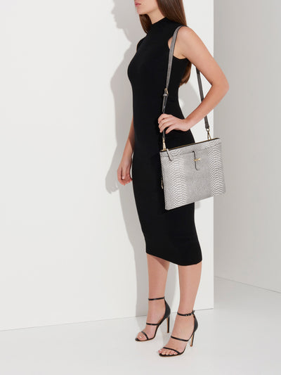 The Tycoon - Snake Embossed Leather Laptop Bag and Sleeve - Model Wearing Laptop Bag on Side - She Lion