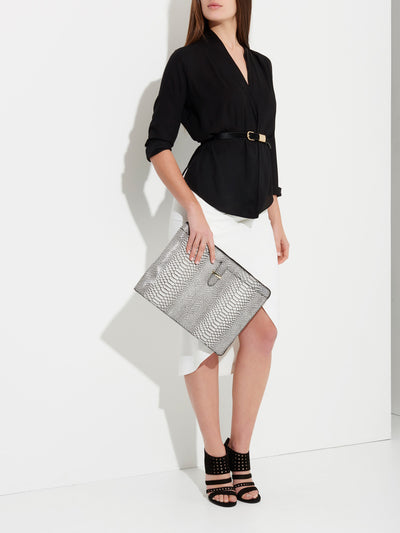 The Tycoon - Snake Embossed Leather Laptop Bag and Sleeve - Model using Bag as Clutch - She Lion