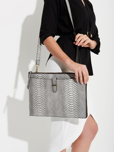 The Tycoon - Snake Embossed Leather Laptop Bag and Sleeve - Front View with model using Laptop Bag on SideShe Lion