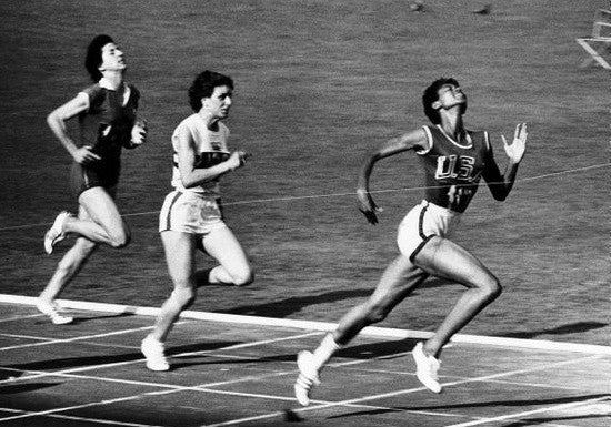 Rudolph wins the women's 100 meter dash at the 1960 Summer Olympics in Rome.