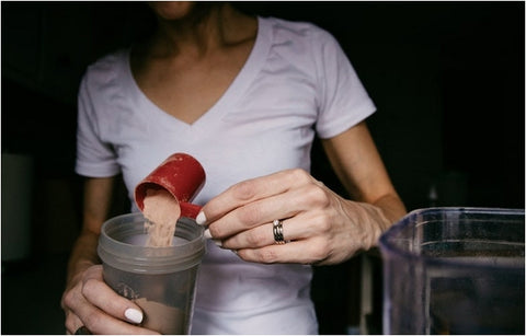 Girl making a protein shake