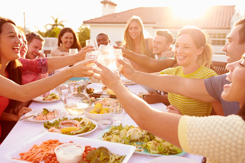 summer bbq with friends clinging stemless wine glasses | Alterre