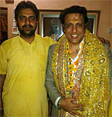 Eshwar Bhakti priest with Bollywood star Govinda