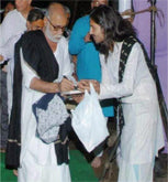 Eshwar Bhakti priest with Morari Bapu