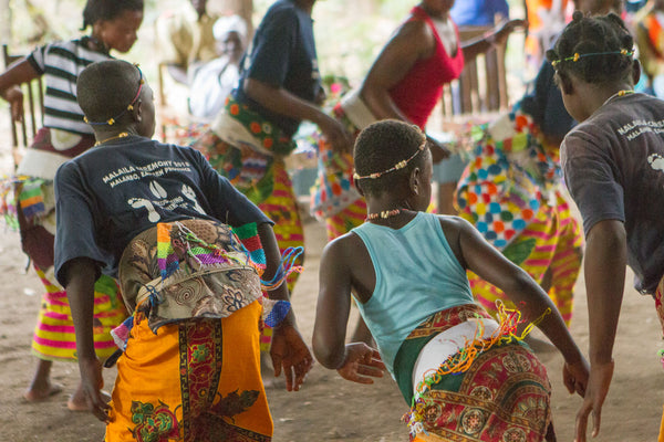Tribal Textiles South Luangwa Zambia: Malaila dancers performing at Family Day