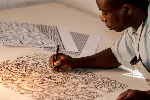Artisan drawing a new print - Tribal Textiles