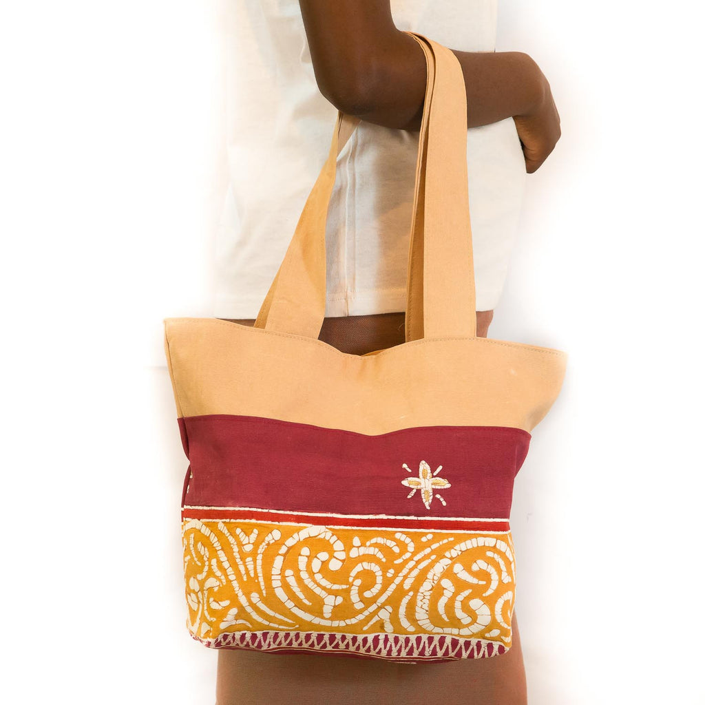 Contemporary african Handbags in stylish reds