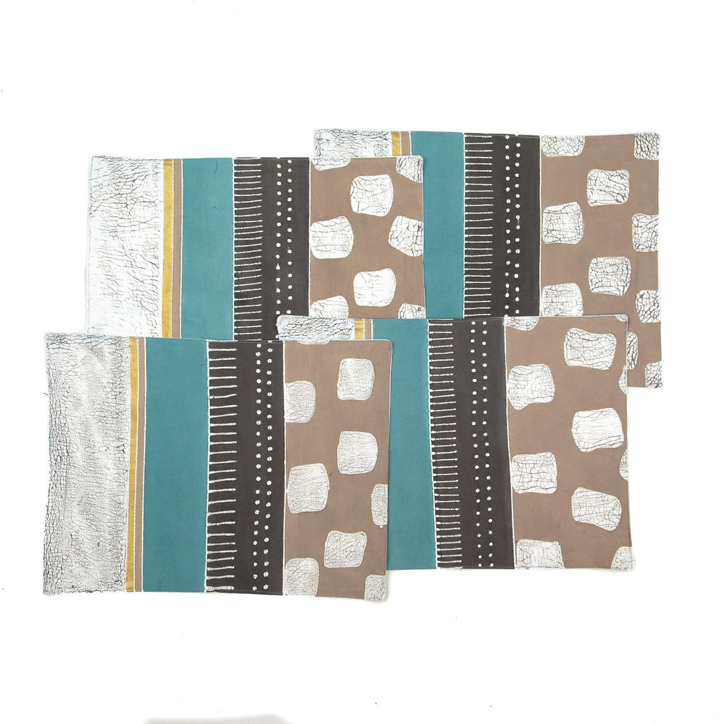 Handmade African placemats with geometric patterns in light teal and grey colours