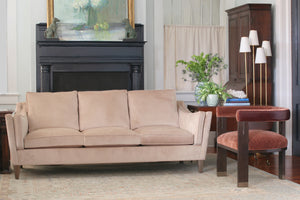 Vignette with Lake Sofa in gold velvet and George Occasional Chair